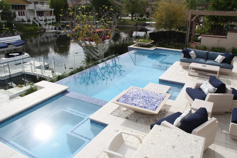 Contemporary design pool and spa with fire features and patio area