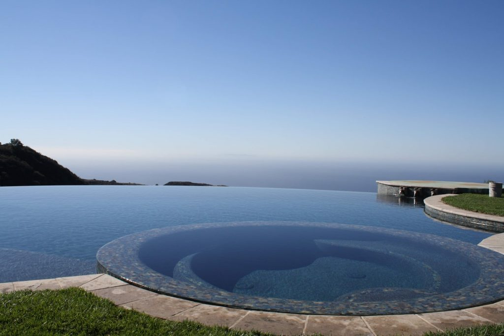 Vanishing edge pool with a view of the surrounding landscape