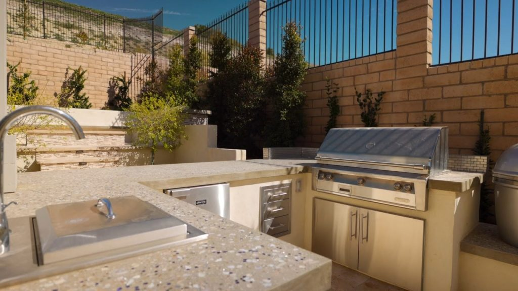 Outdoor kitchen with grill and recycled glass countertop