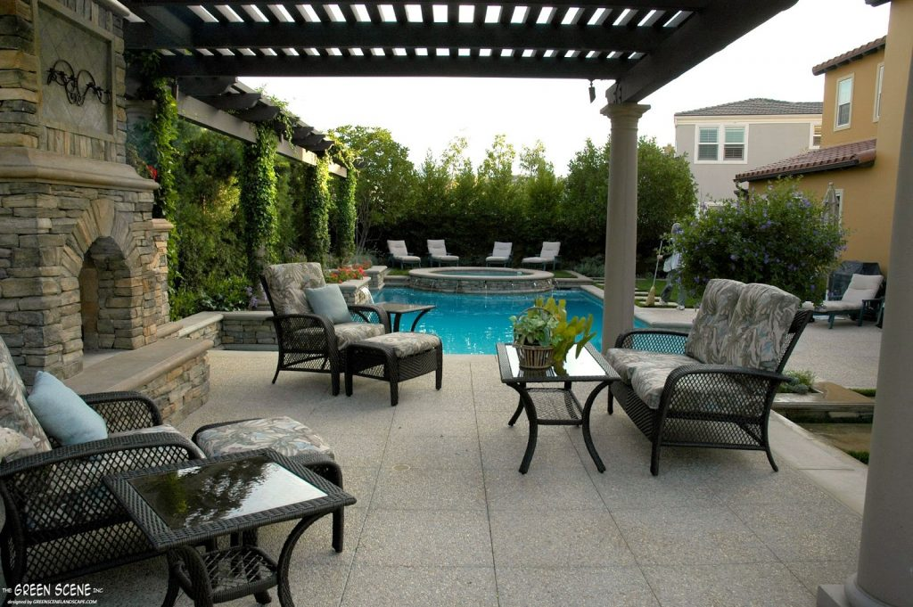 A covered outdoor living space with pool and privacy from nosey neighbors