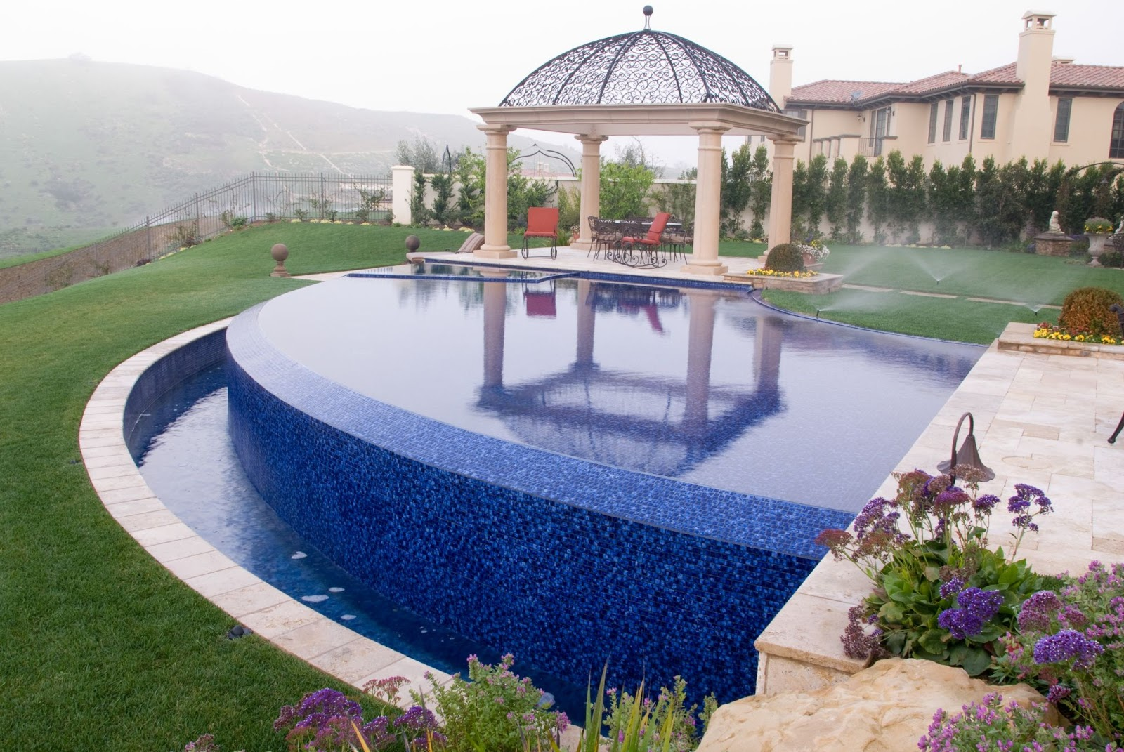 A swimming pool and a lawn uses more water