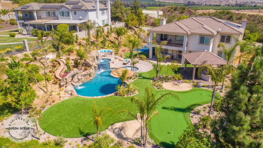 backyard private water park with pool, golf course, slide and outdoor kitchen