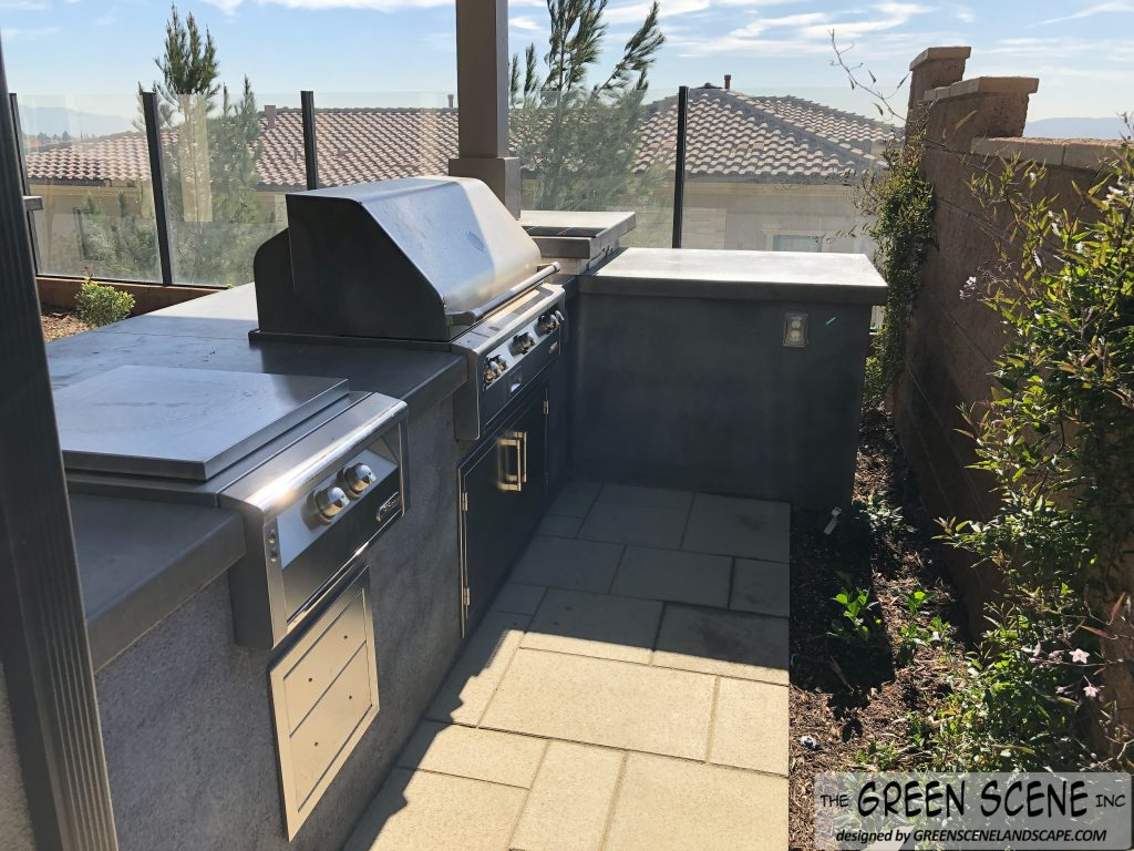 outdoor kitchen will grill and landscaping