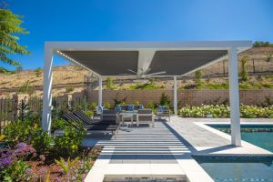 outdoor room design for an outdoor kitchen and a swimming pool